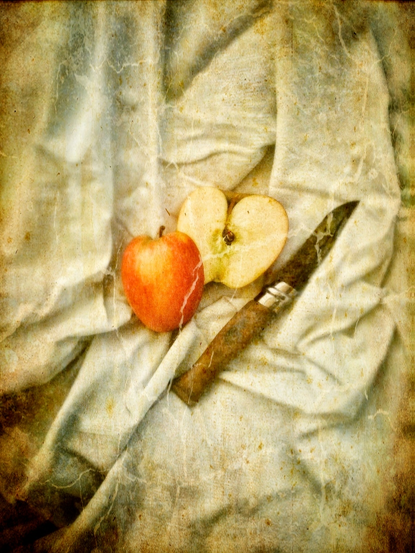 Photographic still life of apple imitating classical painting
